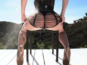 Kissable brunette Chanel Preston posing and teasing outdoors