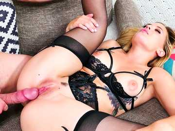 Blond Sloan Harper doesn't feel shy to show her pink nipples and sexy stockings to a guest.