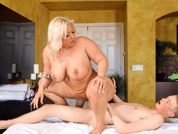 Mz Dani licks delicious cum after fucking a younger guy on the massage table