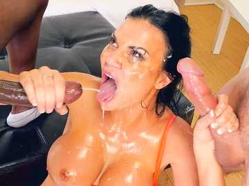 Oiled whore Jasmine Jae takes two dicks in her soft hands and pleasures them with mouth