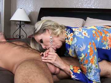 Hungry blonde in sexy stockings Julia Ann wakes up the beast with her mouth