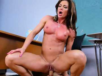 Athletic body of MILF Nina Dolci exhausts the teacher's puppet in classroom
