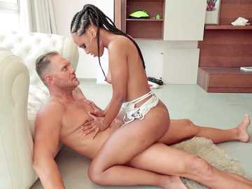 Ebony beauty Noe Milk athletically hops on the big cock of Nacho Vidal