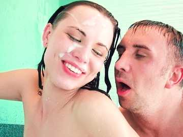 Balls licking in the shower ends with facial cumshot for young Aidra Fox
